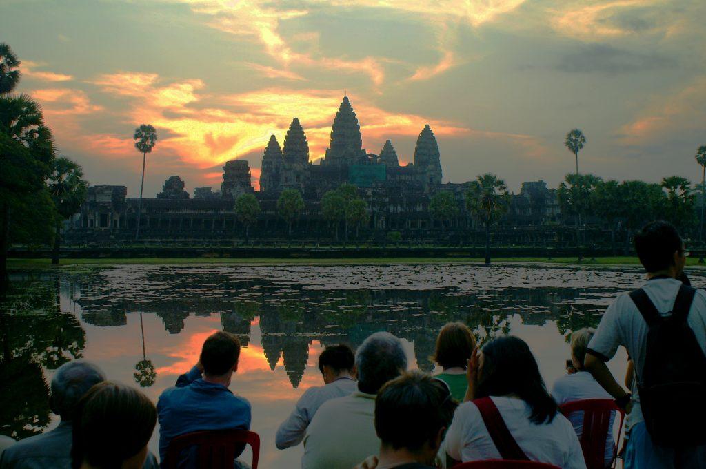 tourists taking photos of angkor wat
