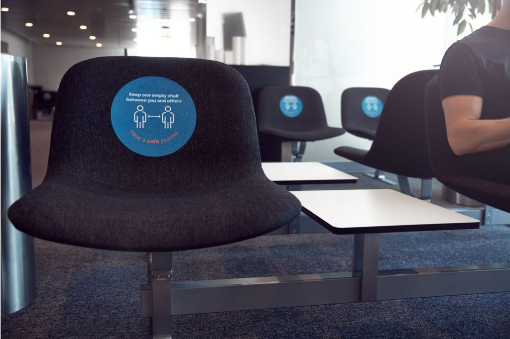 social distancing chair in an airport