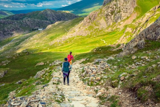 hikers walking through Welsh countryside