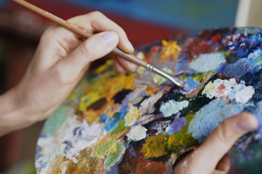mixing paints on an artist's easel